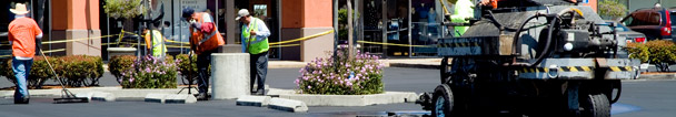 Shopping Center paving and concrete installation and repairs, ADA marking